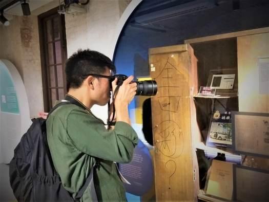 photographer-photographing-tai-kwun-101-exhibit