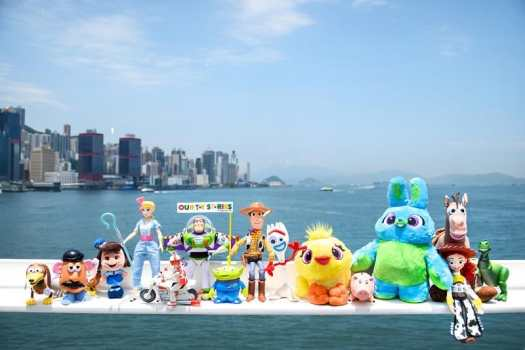 toy-store-characters-against-hong-kong-skyline