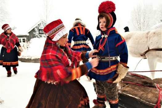 sami-mother-with-child-in-national-costume