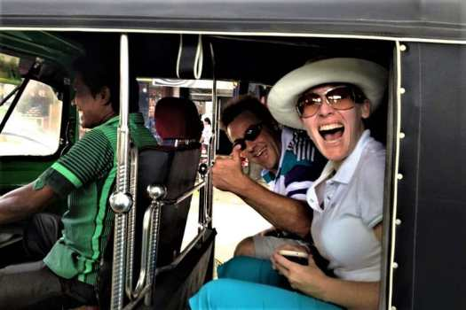 tourist-riding-in-a-tuk-tuk-in-bangkok-thailand