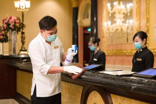 hotel-staff-sanitize-front-desk