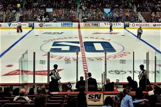 vancouver-canucks-50th-anniversary-logo-on-ice-rink