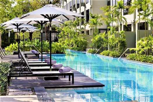 lounge-chairs-overlooking-swimming-pool