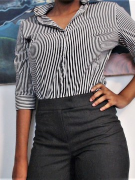 woman wearing striped black and white collared shirt and gray pants clothes