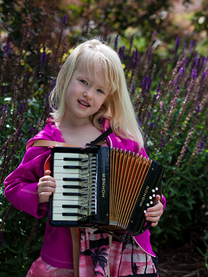 Five year old Ivy loves playing accordion.