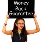 Money Back Guarantee Board Held By Girl