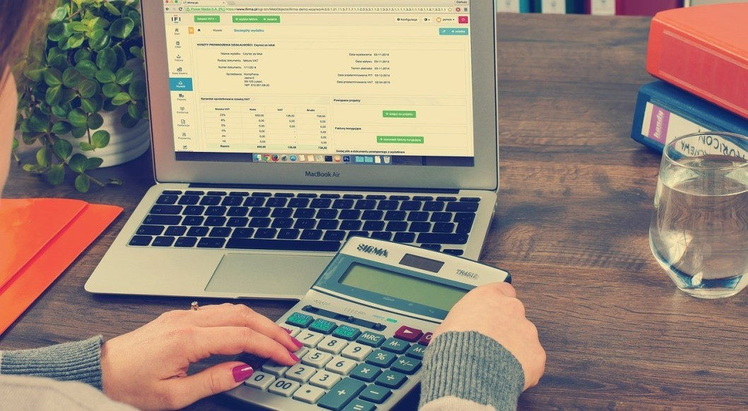 what are bookkeeping tasks image of calculator and tax document