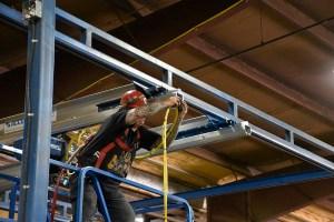 bridge festooning installation for moving a crane system for over a brake metal