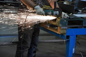 sparks fly as we cut off excess metal in this relocation of a crane