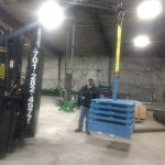 heavy duty forklift moving large overhead bean of a building crane