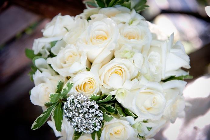 e298a86db06 Romantic bridal bouquet of large white roses blue thistle
