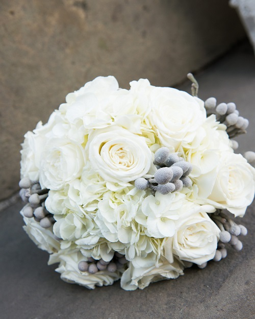White Bridal Bouquet Of Roses And Babyu0027s Breath.