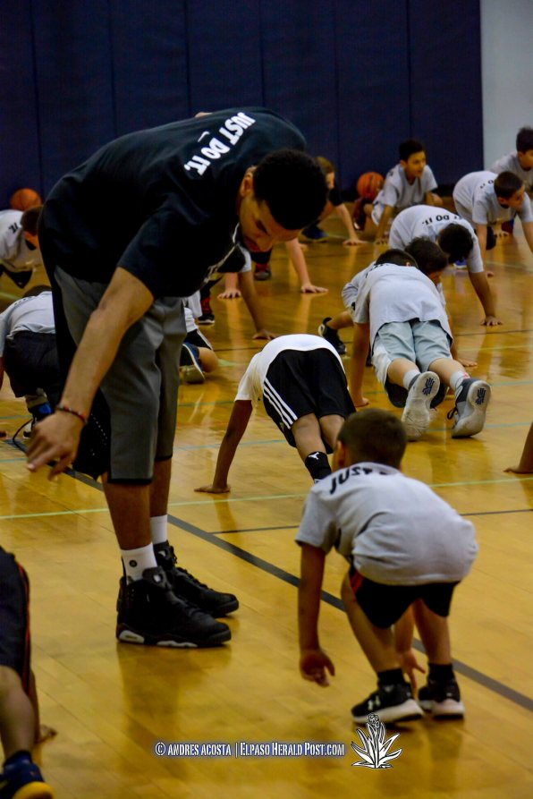Danny Green of the San Antonio Spurs helping one of the camp participants during the 2016 Danny Green Basketball Camp Day 1, Held at the Don Haskins Recreational Center