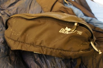 The lid is one of my favorite things about the bag. All my personal items come right into the tent with me.