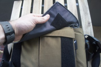 The hook panel on the inside of the flap falls short of the loop panel when fully loaded and abrades the small pocket flap.