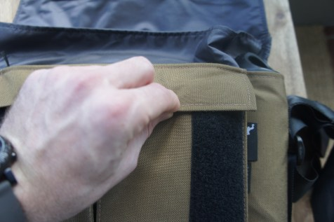 The two smaller front pockets are rather small and difficult to secure with anything substantial in them.