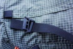 When I looked at the damage in greater detail, I noticed that the webbing was routed through the ladder lock on the Fidlock incorrectly. So I tried to remove the buckle and reroute the webbing in the correct sequence.