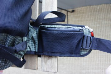 Stretch woven pocket on one side of the belt.