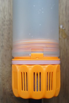The filter locks into the inner unit with the small rectangular tab.
