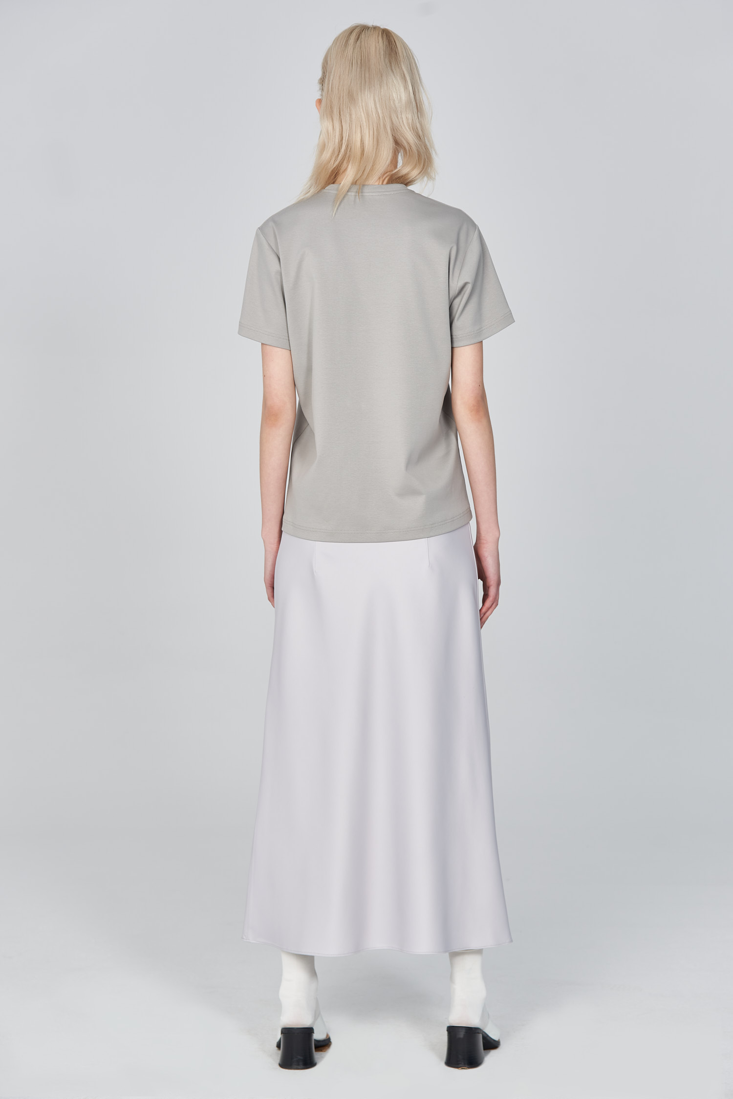 Acephala Ss21 Grey Logo T Shirt Silver Satin Skirt Back