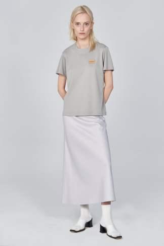 Acephala Ss21 Grey Logo T Shirt Silver Satin Skirt Front Relaxed 1