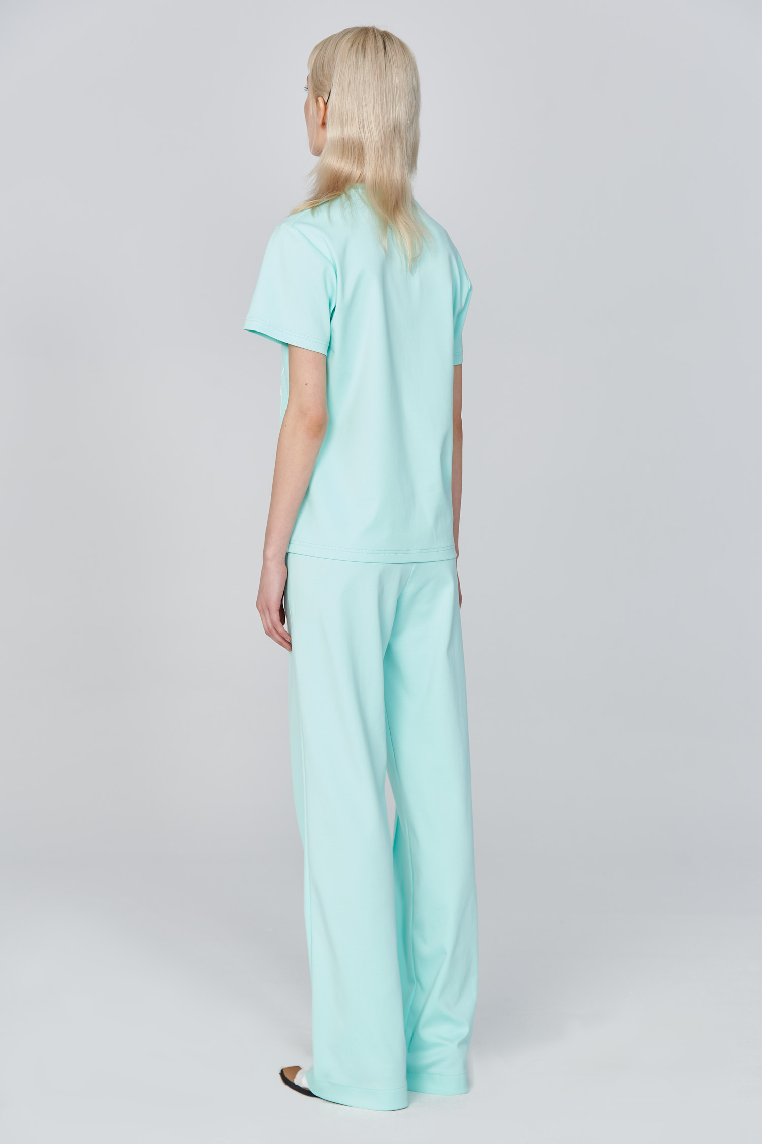 Acephala Ss21 Mint T Shirt Flared Trousers Back Side