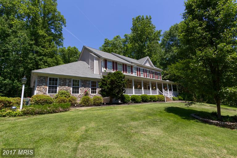 Gorgeous one of a kind home on cul de sac backing to acres of woods with rambling stream.
