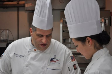 Team member Andy Chlebana (left) and team apprentice Laura Johnson-Lachowecki (right) working on the final dessert
