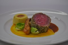 Horseradish-crusted Beef Strip Loin with Semolina Dumplings, Celery Root/Truffle Presse, Brussels Sprouts and Madeira Jus