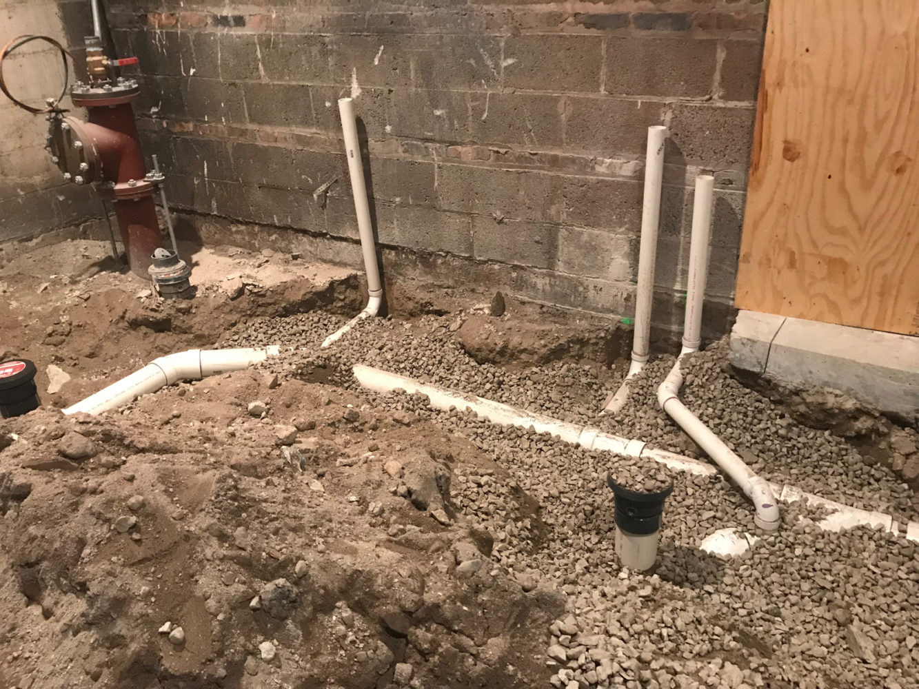 The underground plumbing work as begun at Community Animal