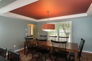 Bright color in Tray Ceiling adds pizazz to this dining space