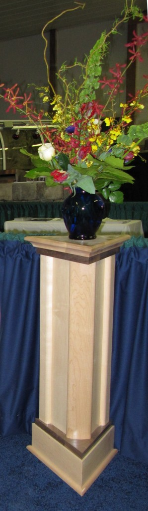 photo of triangular wooden plant stand built by Acheson Builders