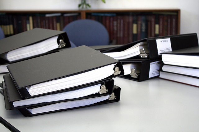 Stacks of dissertations on a library desk