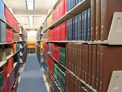 Bound journals on library shelves.