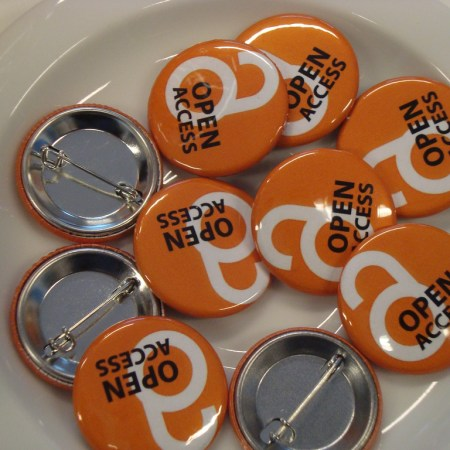 Orange badges emblazoned with the OA logo