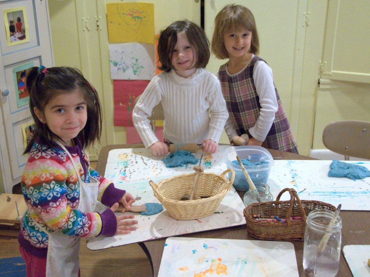 Three girls, aged around 7, engaged in craft actitivies
