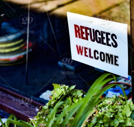 Sign on windowfront stating 'refugees welcome'