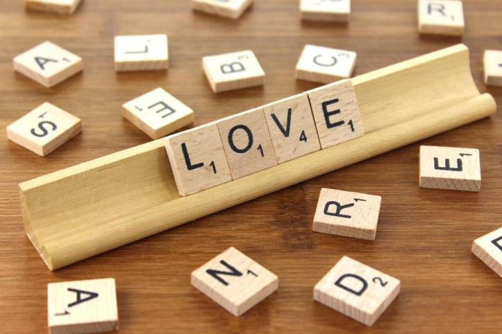 Scrabble tiles forming the word love