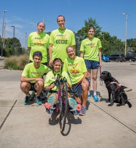 Top Row from left to right : Athlete Ricky Jones Guide Brandon Bradford Athlete Annie Donnell and Annie's Guide Dog Hikari Bottom row from left to right: Olaf Wasternack, Sara Solomon, Amy Harris