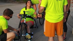 Sara Solomon getting in her handcycle