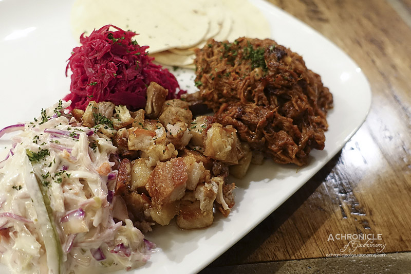 The Bank on Collins - Duo Pork Board - Slow-cooked Pulled Pork and Slow Roasted BBQ Pork with Crackling, Purple Pickled Horseradish Coleslaw, House Made Jalapeno Coleslaw, Mini Corn Tortillas