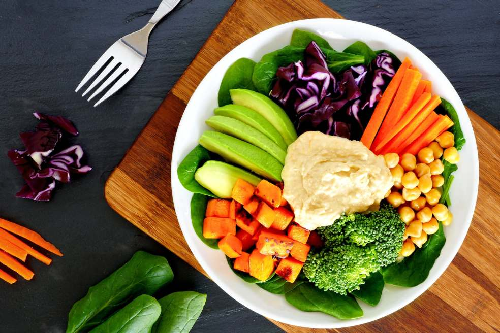 52586089 - healthy lunch bowl with super-foods and fresh mixed vegetables, overhead scene on slate