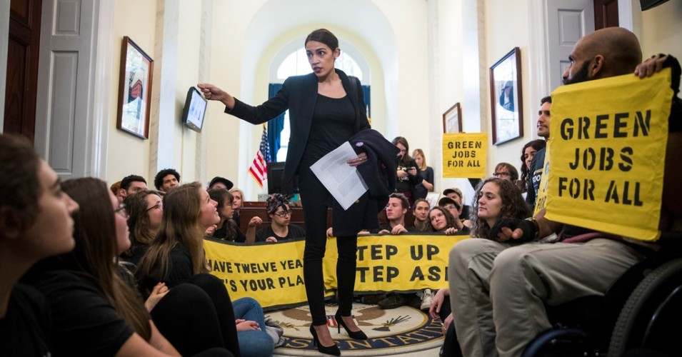 Representative Alexandria Ocasio-Cortez speaks to activists in the offices of House Minority Leader Nancy Pelosi.