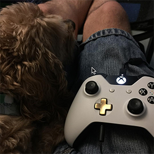 Brian With His Dog Playing Xbox