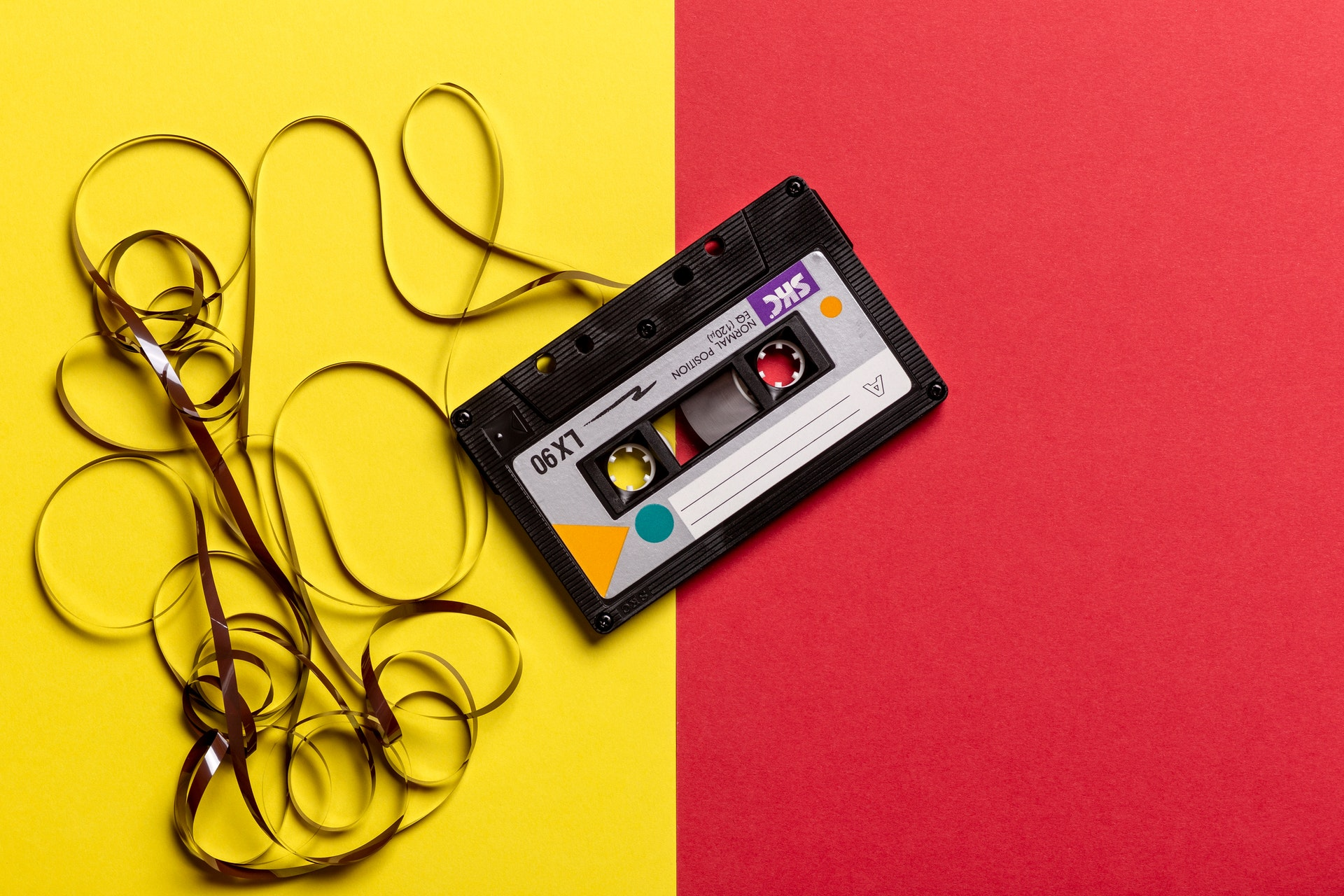 photo of a cassette tape on a colorful background
