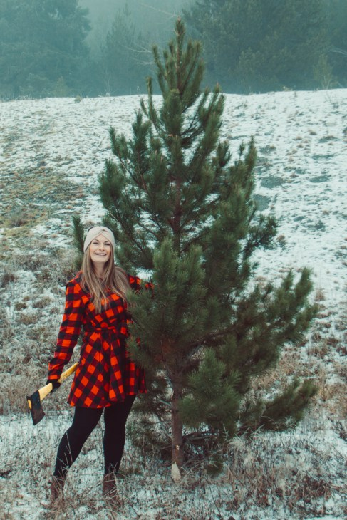 Cutting our own Christmas tree in the most Canadian clothes I own