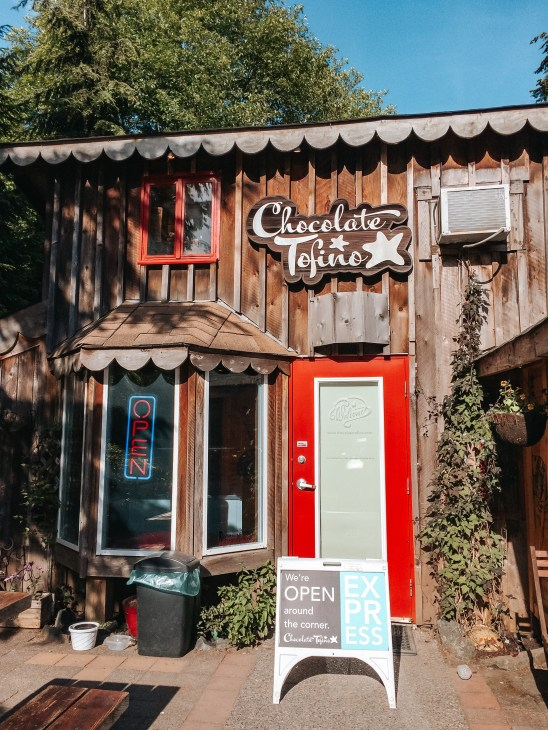 Chocolate Tofino - outside interior of chocolate and gelato shop with red door and logo