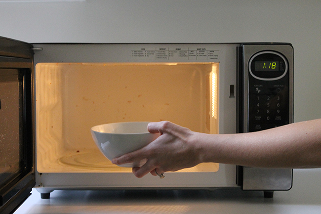 Clean your microwave with a bowl of lemon slices and water