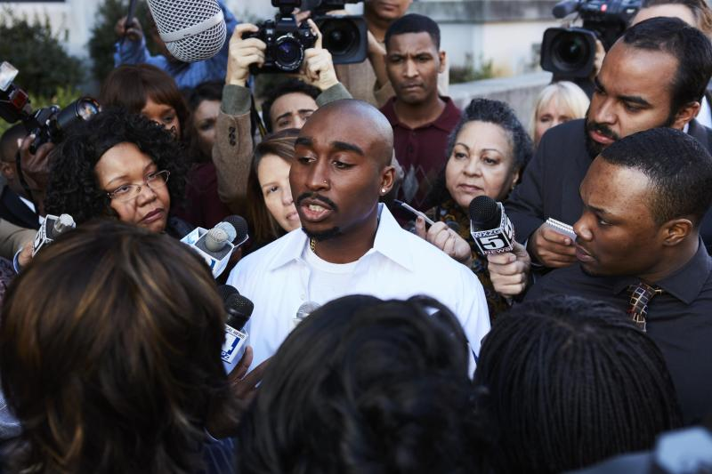 Tupac Shakur (Demetrius Shipp Jr) holds a press conference in 'All Eyez on Me' - DOP Peter Menzies Jr