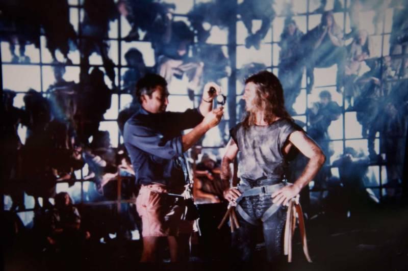 Semler lighting Mel Gibson on the set of 'Mad Max Beyond Thunderdome' in 1985 - PHOTO Jim Sheldon